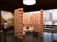 Raumteiler mit perforiertem und geschwungenem Aufbau
