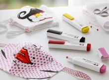 Mund-Nase-Masken aus Stoffresten werden mit Textilmarkern zu echten Unikaten