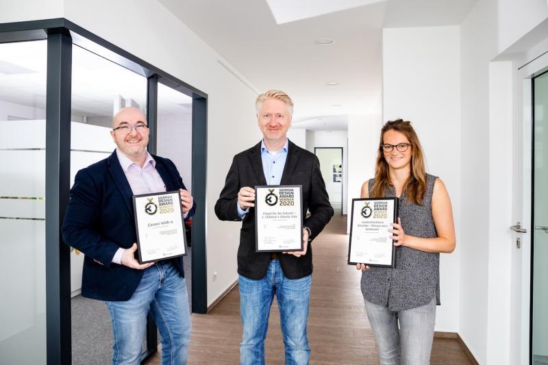 Die team4media-Geschäftsführer Axel Voss und Jörg Fiedler sowie Grafik-Designerin Franziska Prenzler